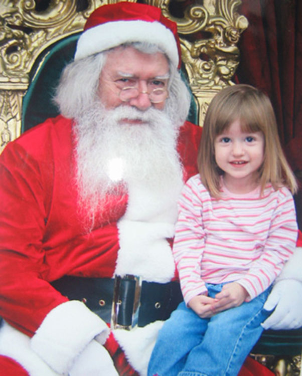 A Child Visits Santa in a Shopping Mall[Source]