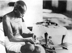 Fig. 2. Mahatma Gandhi, Father of the Indian Nation, at His Spinning Wheel in 1942