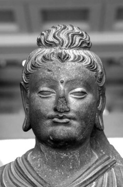 Fig. 20. Standing Buddha. Detail. Provenance unknown. H. 104 cm. British Museum.