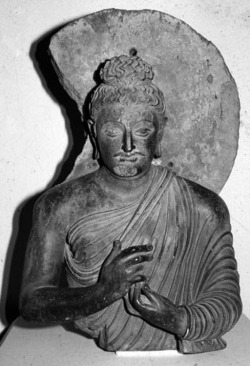 Fig. 21. Seated Buddha. Provenance unknown. H. 80 cm. National Museum, Karachi.