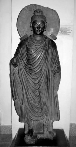 Fig. 55. Buddha. Provenance unknown. Peshawar Museum.