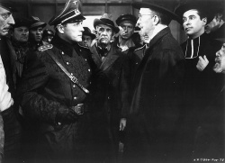Figure 1. Gestapo Chief Haas (Tonio Selwart) questions Professor Novotny (Walter Brennan) in Hangmen Also Die (1942), written by Brecht in collaboration with Fritz Lang. (Photo copyright 1943 United Artists Corp.; courtesy of the Museum of Modern Art)