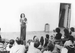 Figure 7. Carolee Schneemann lecturing at Millenium Film Retrospective. New York, 1976. Photo: Bob Parent.
