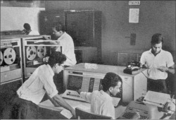 "Fig. 2. Students working on the IBM 1620 computer at Kanpur, circa 1964 (note the IBM ""Think"" sign on the wall). (Source: Indian Institute of Technology, Kanpur, 1965 Convocation publication, p. 23. Reproduced courtesy IIT Kanpur and CMU University Archives.)"