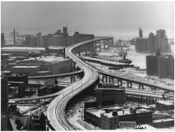 Figure 3. This 1962 winter view of the Skyway reveals the structure's four curves and its setting, between banks of grain elevators. Courtesy, Buffalo and Erie County Historical Society.