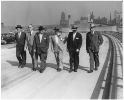 "Figure 4. Two weeks before the opening of the Skyway, city and state officials walked a portion of the span during an ""official inspection trip."" From left are John Leone, Charles T. Love, John K. Vane, Elmer G. H. Youngmann, Mayor Steven Pankow, and Walter Mayday. Courtesy, Buffalo and Erie County Historical Society."