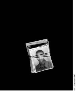 "Figure 1. Banded Passport Photographs (2007) by Eric Gottesman. C-print (h: 20"" x 24"")."