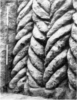 "Fig. 2. Spiral column façade at Tell al Rimah, northern Iraq, Middle Bronze Age. (David Oates, ""The Excavations at Tell Al Rimah, 1966,"" Iraq 29 (1967), pl. XXXII.b.)"