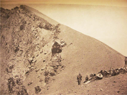 Figure 2. Azufreros and guests on the rim of the crater. (Source: )
