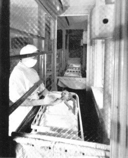 "Figure 3. Reyniers's Baby Cubicle. Source: I. Rosenstern and E. Kammerling, ""Air Conditioning, Ultra Violet Light, and Mechanical Barriers as Factors in the Prevention of Cross Infections in Nurseries,"" in Micrurgical and Germ-Free Techniques: Their Application to Experimental Biology and Medicine, ed. James A. Reyniers (Springfield, Ill.: Charles C Thomas, 1943), 233-59, 241. Reprinted with permission."