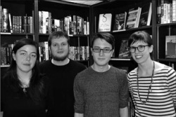 Fig. 2. NYC Moby-Dick Marathoners on The Third Day at Housing Works Bookstore Cafe, on Crosby St. in Manhattan, l. to r.: organizers Amanda Bullock, Justin Taylor, and Polly Bresnick, with Aaron Calvin (second from right).