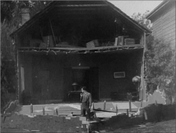 Fig 1. Will survives the falling house in Buster Keaton's Steamboat Bill Jr. (1928).
