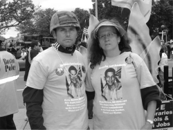 Figure 3. Carlos and Mélida Arredondo getting ready to participate in the annual Dorchester Parade, June 2, 2012. They wore T-shirts dedicated to Alex and buttons that memorialized Brian. Carlos also wore Alex's helmet as a tribute. Photo by Linda Pershing.