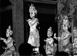 "Figure 3. Kim Sophors and other dancers at Kulen II performing ""Apsara Dance."" Note the Angkorean motifs of the stage set.<br/><br/>(Photo: Celia Tuch man-Rosta)"
