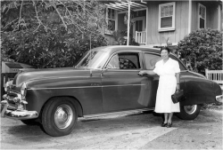 Figure 6. Midwife Elsie Masao Tsuchiyama with her 1950 Chevrolet. Honolulu, ca. 1950.<br/><br/>Courtesy of Bernice Pauahi Bishop Museum.