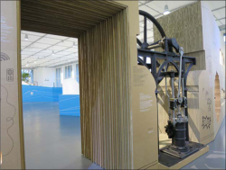 Fig 1. Section of the object wall showing the cut-out cardboard construction and a ca. 1850 steam engine in the Welcome to the Anthropocene exhibit, Deutsches Museum.<br/><br/>(Source: Photograph by Dolly Jørgensen.)