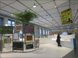 Fig 2. View of the Nature island with the satellite imagery art on the left in the Welcome to the Anthropocene exhibit, Deutsches Museum.<br/><br/>(Source: Photograph by Dolly Jørgensen.)
