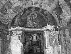 Figure 3. The partial image of Christ labeled Chalkites (lower center right) is seen on the east wall of the narthex of the Church of Saints Nicholas and Panteleemon. To the right of him on the southern wall are the portraits of Tsar Constantine Tich and his wife Irene (lower right). Above their images is the icon of the Miracle of St. Nicholas with the Carpet, in which the saint purchases a carpet from a poor man so that the latter could celebrate the saint's feast day (upper right). Opposite them on the north wall and barely visible here are the figures of Desislava and Kaloian (lower left).<br/><br/>Source: Photo by Vladimir Tsvetkov, 2008.