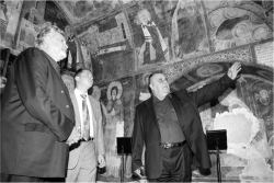Figure 6. Church of Saints Nicholas and Panteleemon, narthex, the Director of the National History Museum Bozhidar Dimitrov explains the frescoes to members of the Bulgarian government.<br/><br/>Source: Photo by Miro Zlatev, 2006.