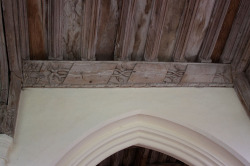 Fig. 7. Example of the paneling in the Lady Chapel of Holy Trinity, Long Melford. The layout, including the vine motif and hand, is similar to that in the Clopton chantry chapel.