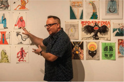 "Fig. 1. Matt Kish with drawings from his mixed media ""The Crew of the Pequod"" series (left) and ""Moby-Dick in Pictures"" series (right) at the Contemporary Arts Center in Cincinnati, April 23, 2016. Image courtesy of Robert Del Tredici."