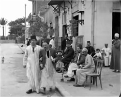 Figure 1. 'Abdu and Chalom leave a café arm-in-arm. Screenshot, The Two Delegates (1934).