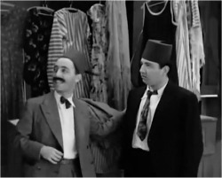 Figure 2. Chalom and 'Abdu purchase suits, screenshot, The Two Delegates (1934).