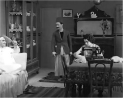Figure 5. Chalom visits Solomon and Vittoria's apartment to ask for Esther's hand in marriage. Screenshot, The Two Delegates (1934).