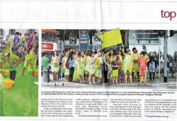 Figure 4. Singapore's The Straits Times (27 October 2013) features a photo of Sharon Chin, holding a flag, and participants of Mandi Bunga, marching through the streets. Source: [accessed 3 October 2016]