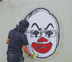 Figure 5. This image of Fahmi Reza wheatpasting his clown-faced portrait of Prime Minister Najib Razak was posted on the artist's Facebook page. It was accompanied by a message to his detractors, inviting them to locate the graffiti. Source: Artist's Facebook page, , 26 August 2016 [accessed 28 March 2017]