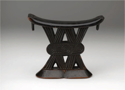 1. Headrest (mutsago) Central or Southern Shona artist, Zimbabwe, early 20th century Wood; 17.1 cm x 20.3 cm x 6.7 cm Gift of Mr. and Mrs. Cedric Marks, 1968 (G.68.24.6) Headrests support the neck of a sleeping person and protect an elaborate hairstyle or headdress. They are also markers of one's allegiances. Terms like Zulu and Shona, associated with cultural traditions and kingdoms, are not static identities. Are there identities or allegiances in your life that are static and some that change? An individual commissioning a headrest could show the patron's or artist's ties with a group through style. The six-legged headrest in this case features a zig-zag pattern on the side of each leg. This may reference royal jewelry and raised bump designs that became a hallmark of Zulu style. The Shona headrest features a base and platform separated with an elaborate, flat geometric design composed of V's and circles. There are many variations on Shona style that feature these basic components; the multiple allegiances and stories conveyed by this work are still debated by scholars. —EP Note: All image captions provided In this preview are advanced drafts of label copy written for a general audience. Didactic questions are emphasized based upon the results of visitor surveys seeking greater personal connections with artworks and collaboration with museum education staff. Initials indicate which coauthor wrote the caption.