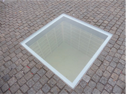 Figure 1. Micha Ullman, Library (1995), a memorial to books burned in the Holocaust, located in Berlin's Bebelplatz, the site of public burning of tens of thousands of books on May 10, 1933. Photo by author.
