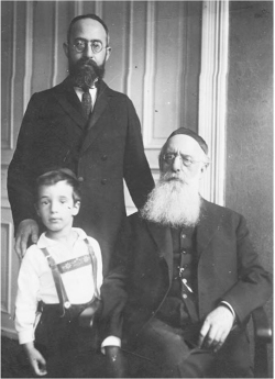 Figure 1. Three generations of the Birnbaum family in 1931: Solomon A. (standing, behind), Jacob (standing, front left), Nathan (sitting). Photo courtesy of the Nathan and Solomon Birnbaum Archives, Toronto.