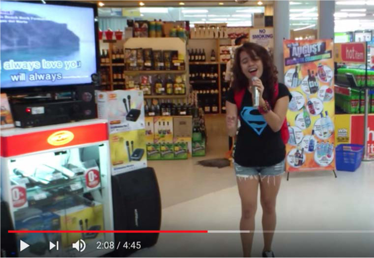 "Figure 3. Zendee Rose Tenerefe sings ""I Will Always Love You"" at SM Megamall in Mindanao. When the video was originally posted, Tenerefe was known as ""Random Girl."" From the video ""Random Girl in the Mall Blows Everyone Away …,"" YouTube, September 16, 2012. (Source: Author's screenshot.)"