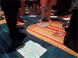 Fig. 2. After sharing in small groups, contributors laid out their materials on the carpet, where participants walked around to view them. (Source: Courtesy of the authors.)