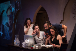 Figure 2. Naomi Wright, Greg Gale, Carlos Gonzales-Vio, and Dalal Badr play themselves interviewing a Syrian playwright over Skype. (Photo: James Heaslip.)