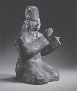 Figure 2.1. Green-glazed female musician, one of over 350 figurines found in the tomb of Sima Jinlong (d. 484) at Datong, Shanxi (China); height: 21 cm. After James C.Y. Watt et al., eds., China: Dawn of a Golden Age (New York: The Metropolitan Museum of Art, 2004), No. 70. Original archaeological report published in Wenwu 3 (1972).