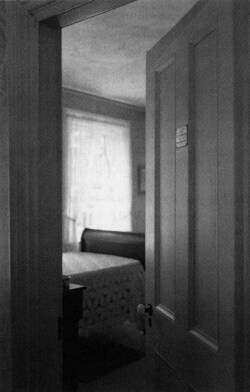 Figure 6. A door ajar onto Dickinson's bedroom. Photograph by Frank Ward.