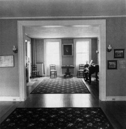Figure 7. The Dickinson parlor. Folding doors originally separated the space between the front and back parlors, allowing Dickinson to play the piano, unseen, for visitors. Photograph by Frank Ward.