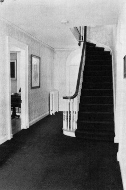 Figure 8a. View of staircase, looking toward the back door. Photograph by Frank Ward. Trustees of Amherst College.