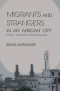 Migrants and Strangers in an African City cover